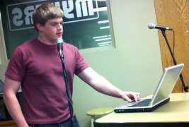 """DSU junior Nic Brosz kept his keyboard closer than some in the /afk readings, but nonetheless led listeners on a """"first voyage"""" in his reflective initiation story . Photo by Prof. Nathan Edwards."""