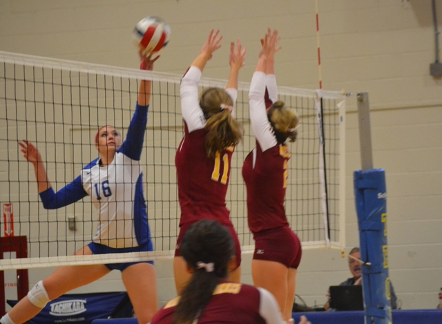 Trojans Dig Pink and Win Back to Back