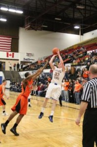 Senior forward Luke Lamb shoots over a Jamestown defender. Lamb recorded a double-double in the exciting win, with 15 points and 10 rebounds. (Photo provided by DSU Athletics)
