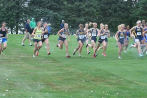 DSU's Lady Trojans running in the rain during the Herb Blakely Invitational