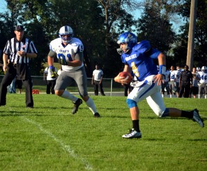 Justin Summers racing away from Mayville State defenders.