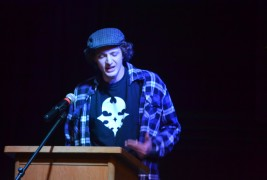 Andrew Koerner lays the poetry hammer down on some unwary faculty at the recent Slam competition.